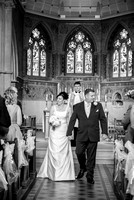 Surrey Wedding Photographer / Wedding in Caterham / The wedding couple walking through the church aisle / Black and white wedding photography