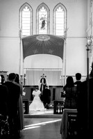 Surrey wedding photographer / St Johns Church Coulsdon Wedding / Bride and groom kneel at the altar / The wedding couple praying