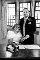 Surrey Wedding photographer / St Johns Church Coulsdon Wedding / The groom holding brides hand while she's sitting down