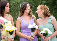 Surrey wedding photographer- bridesmaids laughing