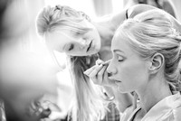 Surrey wedding photographer- Bridal Preparation- bride getting makeup done