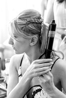 Surrey wedding photographer-Bridal Preparation- bridesmaid curling hair
