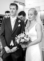 Surrey wedding photographer / Tyrrells Wood Golf Club Wedding /  The groom and the bride in the reception