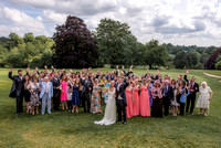 Surrey wedding photographer / Tyrrells Wood Golf Club Wedding / The wedding couple with the guests waving  Wedding group photo