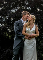 Surrey wedding photographer / Tyrrells Wood Golf Club Wedding / The bride and groom hugging and looking into each other eyes