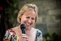 Surrey party photographer-themed wedding- woman giving a speech