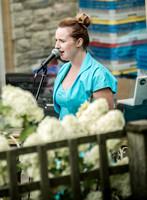 Surrey party photographer- themed party- woman singing