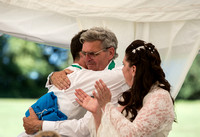 Surrey wedding photographer / marquee wedding (4) / Wedding guests hug