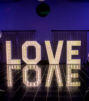 "East Grinsted Wedding Photographer / yew lodge weddings / ""Love"" shining statue lights"