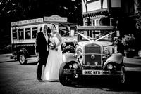 East Grinstead Wedding Photographer / yew lodge weddings /  The bride and groom next to the wedding car