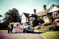 East Grinstead wedding photographer / yew lodge weddings / Family photo / The wedding couple with kids / Kids Bridesmaids and Grooms-maids / Old style wedding car