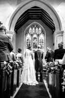 surrey wedding photographer- chaldon church- bride and groom at the aisle