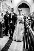 surrey wedding photographer- chaldon church- bride and groom black and white