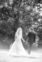 Surrey wedding photographer- bride and groom walking