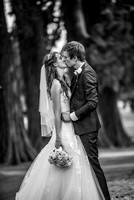 surrey wedding photographer- kissing in black and white