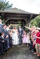 Kent wedding photography / St Mary's Church Ide Hill Wedding / Guests throwing flowers leaves at the new married couple