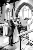 Kent wedding photography / St Mary's Church Ide Hill Wedding / The wedding couple singing at the altar