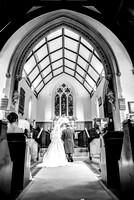 Kent wedding photographer / St Mary's Church Ide Hill Wedding / The back view on the wedding couple at the altar