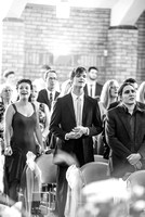 Surrey wedding photographer / reigate baptist church (4) / Guests singing during the wedding ceremony
