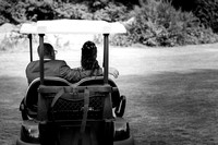 surrey wedding photographer- leatherhead registry office- bride and groom in golf cart
