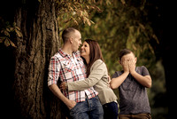 Surrey wedding Photographer Pre wedding shoot (16) /  Couple hugging and leaning on the tree / Funny family photos