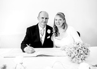 Surrey wedding photographer - reigate hill golf- the groom and bride signing the register