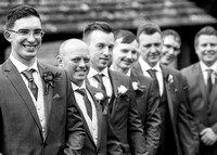 Surrey wedding photographer Godstone Church Wedding Groom with the grooms-maids
