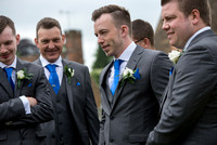 Surrey wedding photographer godstone church wedding The grooms-maids with blue ties