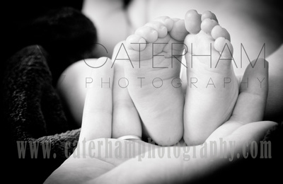 New Born Photographer-  Surrey photographer - amazing baby feet portrait