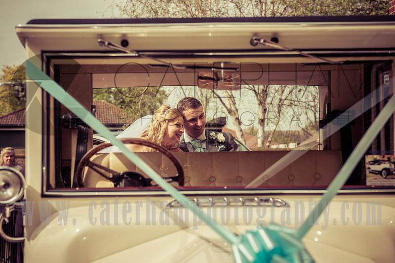 Surrey wedding photographer vintage wedding bride and groom in vintage car beautiful