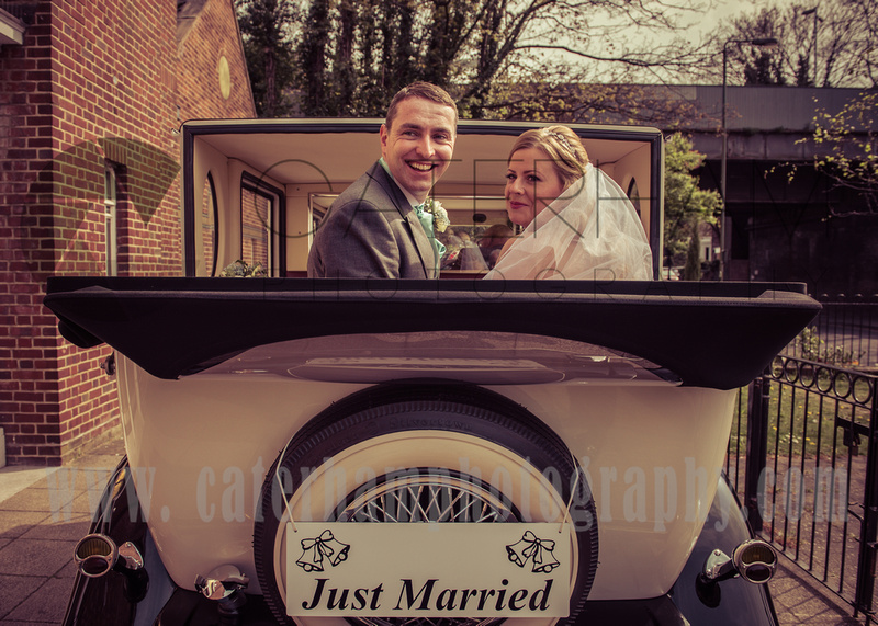 surrey wedding photographer vintage wedding / just married couple in the wedding car vintage