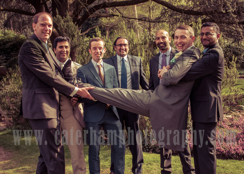 Surrey wedding photographer Wedding in South croydon boys at the wedding groom and best man being held