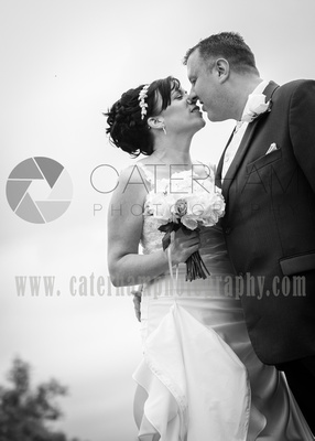 Surrey wedding photographer / Wedding in Caterham / Bride and groom kissing / Black and white wedding photos