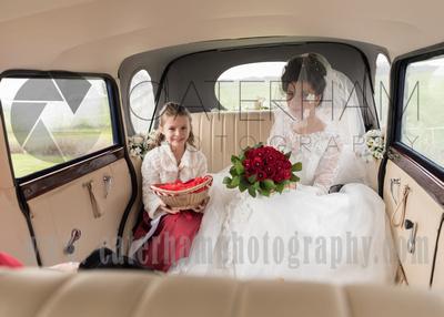 Surrey Wedding Photographer- Warlingham Farleigh Golf Club-Bride and her flower girl in a wedding car