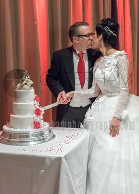 Surrey Wedding Photographer- Warlingham Farleigh Golf Club- Bride and Groom Cutting the wedding cake