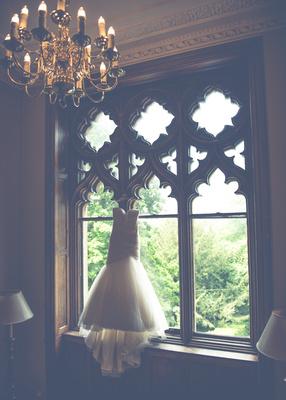 Surrey Wedding Photographer- Nutfield Priory- Wedding Dress Hanging