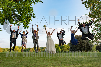 Surrey wedding photographer - Hartsfield Manor- Breath-taking grounds with Bride and Guests jumping