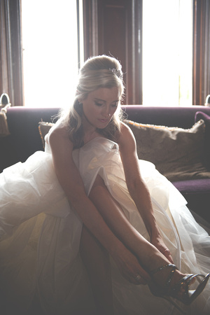 Surrey Wedding Photographer- Nutfield Priory- Bride putting on shoe