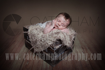 New Born Photographer-  Surrey photographer - cute baby in a box