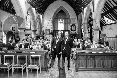 Surrey wedding photographer- Photographed Wedding at St Mary's Church in Dorking- groom and best men in a traditional Church Wedding Venue