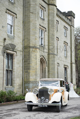 Surrey Wedding Photographer- Chiddingstone Castle- car arriving at venue