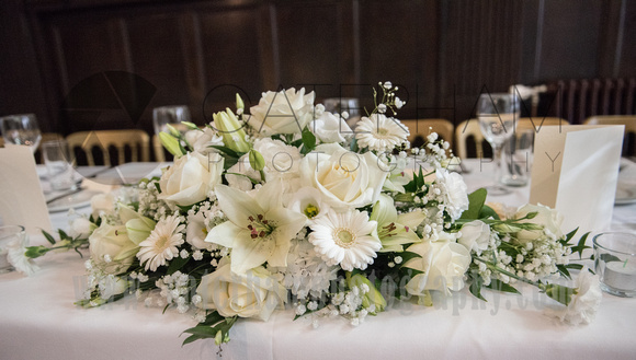Surrey Wedding Photographer- Chiddingstone Castle- flowers on top table