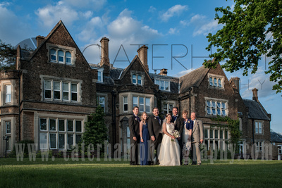 Surrey wedding photographer - Hartsfield Manor- Bride and Guests stood in front of amazing venue