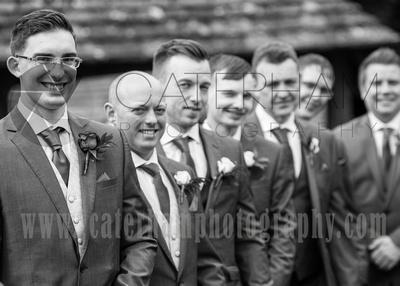 Surrey Wedding Photographer- St Nicholas Church Godstone- Wedding Party happily smiling at Wedding venue