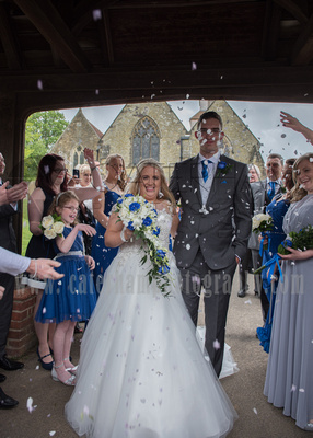 Surrey Wedding Photographer- St Nicholas Church Godstone- Bride and Groom Leaving the Church after a moving service