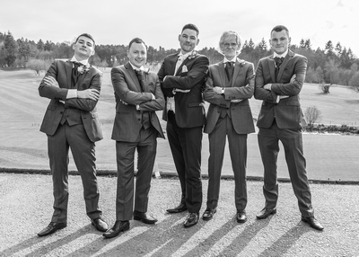 Surrey Wedding Photographer- Wedding ceremony at westerham golf club- Groom and best men stood outside wedding venue
