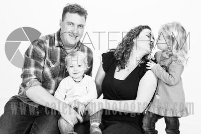 Surrey Portrait Photographer-  Surrey photographer - Great family portrait and give mum a kiss