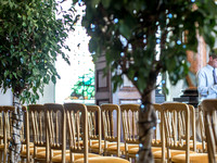 Surrey Wedding Photographer- Kingston county hall - Chairs and trees in the ceremony venue