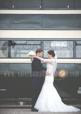Surrey Wedding Photographer- Wedding ceremony Chiddingston Castle- Bride and Groom together by wedding bus