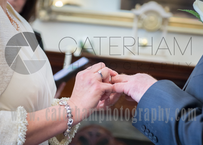 Surrey wedding photographer- leatherhead register office-bride and groom giving rings